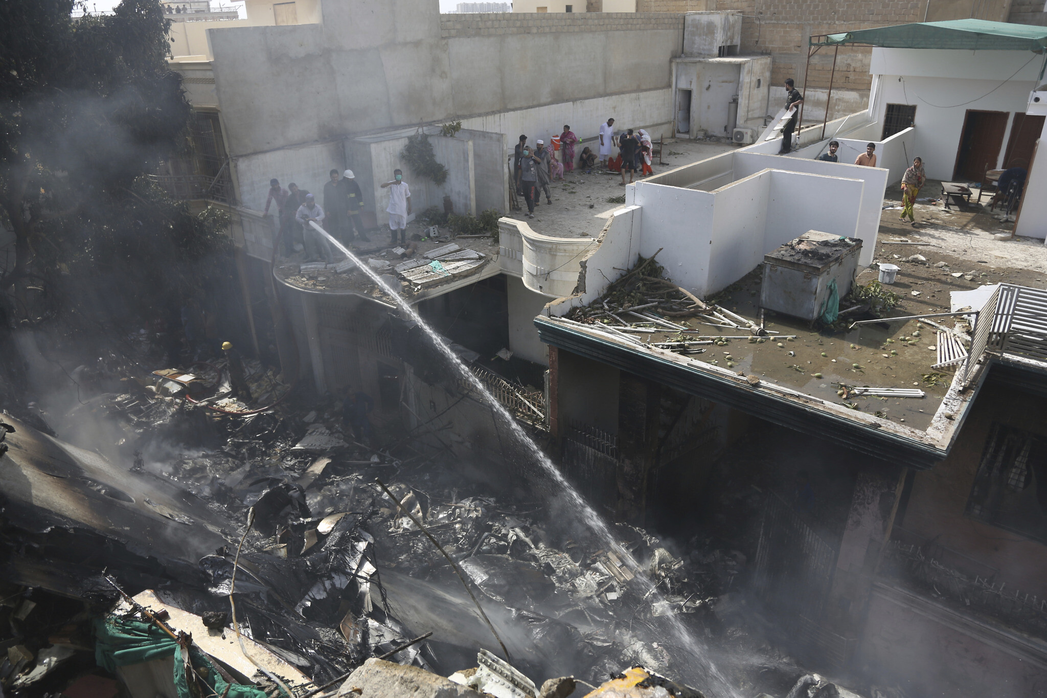 Pakistan plane crashes in residential area.